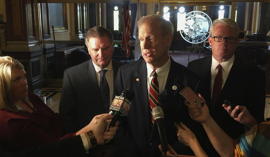 In this May 8, 2018, photo, Gov. Bruce Rauner, center, addresses reporters outside his state Capitol office in Springfield, Ill. (AP Photo by John O'Connor, File)