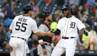 Detroit Tigers' Niko Goodrum, right, celebrates his two-run home run with teammate John Hicks (55) in the fourth inning of a baseball game against the Cleveland Indians in Detroit, Monday, May 14, 2018. (AP Photo/Paul Sancya)