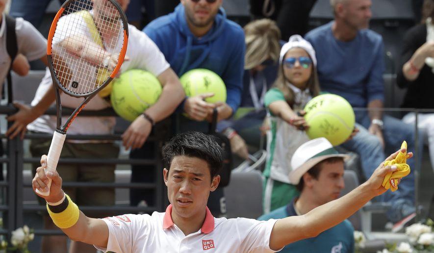 Japan's Kei Nishikori celebrates after winning his match against Spain's Feliciano Lopez at the Italian Open tennis tournament, in Rome, Monday, May, 14, 2018. Nishikori won 7-6 (7-5), 6-4. (AP Photo/Alessandra Tarantino)