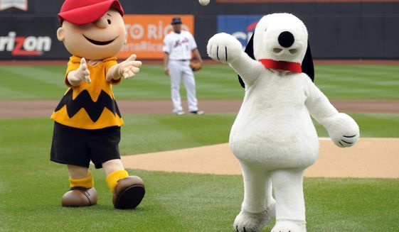 In this Oct. 3, 2009 file photo, Snoopy, right, throws out the ceremonial first pitch while Charlie Brown looks on prior to the New York Mets playing the Houston Astros in a baseball game at Citi Field in New York. Japanese electronics maker Sony Corp.'s music unit is buying a stake in Peanuts Holdings, the company behind Snoopy and Charlie Brown.  Sony Music Entertainment said Monday, May 14, 2018,  it signed a deal with DHX Media, based in Nova Scotia, Canada, to acquire 49 percent of the 80 percent stake DHX holds in Peanuts. (AP Photo/Henny Ray Abrams, File)