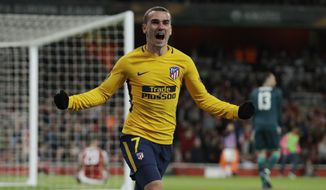FILE - In this Thursday, April 26, 2018 file photo, Atletico's Antoine Griezmann celebrates after scoring the first goal of his team during the Europa League semifinal first leg soccer match between Arsenal FC and Atletico Madrid at Emirates Stadium in London. Marseille will play Atletico Madrid in the Europa League final on Wednesday May 16, 2018. Marseille now enjoys significant financial backing and the time is right to stop harping on about past glory and deliver another trophy. Atletico is bidding to win the Europa League for the third time this decade.  (AP Photo/Matt Dunham, File)