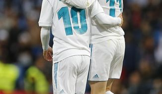 Real Madrid's Gareth Bale, right and Luka Modric embrace after Bale scored his side's 2nd goal during a Spanish La Liga soccer match between Real Madrid and Celta at the Santiago Bernabeu stadium in Madrid, Spain, Saturday, May 12, 2018. (AP Photo/Paul White)