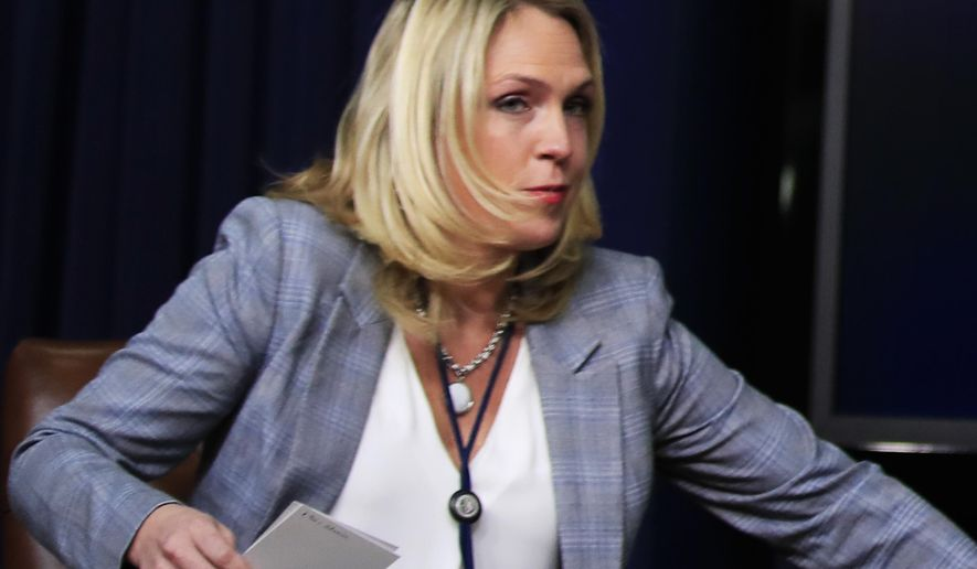 """In this March 22, 2018 photo, special assistant to President Donald Trump, Kelly Sadler attends a forum at the Eisenhower Executive Office Building on the White House complex in Washington. The White House is refusing to condemn a staffer who said during a closed-door meeting that Arizona Sen. John McCain's opinion """"doesn't matter"""" because """"he's dying anyway.""""  (AP Photo/Manuel Balce Ceneta)"""