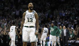 Boston Celtics forward Marcus Morris reacts to a basket during the second half in Game 2 of the team's NBA basketball Eastern Conference finals against the Cleveland Cavaliers, Tuesday, May 15, 2018, in Boston. (AP Photo/Charles Krupa) **FILE**