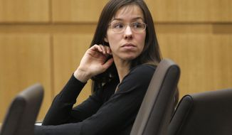 Jodi Arias appears for her trial in Maricopa County Superior court Wednesday, Jan. 9, 2013, in Phoenix. The sensational murder case of Jodi Arias became the trial of the year as the proceedings were broadcast live and were a nightly cable television staple. Arias was convicted in May of killing boyfriend Travis Alexander at his suburban Phoenix home, but the jury failed to decide on her sentence. The case continues to languish in the courts as prosecutors prepare for a retrial aimed at securing a death penalty. (AP Photo/Matt York, File)