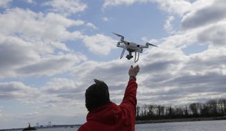 The new legislation would allow the government to confiscate, interrupt communications with, or, if need be, to destroy drones that are seen to be dangers. (Associated Press)
