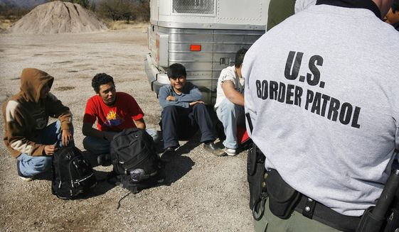 "The $500 million figure split among the ""coyotes,"" or guides, who shepherd the migrants through Central America and Mexico to the border; the stash house operators and smugglers who transport them to their final destinations in the U.S.; and the major cartels that oversee all sides of the operation. (AP Photo/Ross D. Franklin, File)"