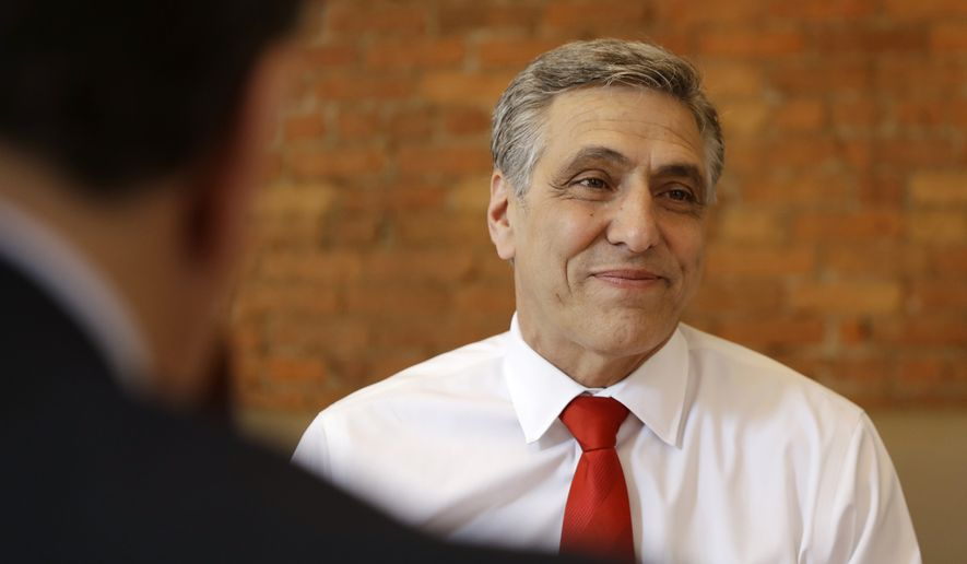 U.S. Rep. Lou Barletta, Republican primary candidate for U.S. Senate, smiles during a lunch gathering, Tuesday, May 15, 2018, in Scranton, Pa. (AP Photo/Matt Slocum)