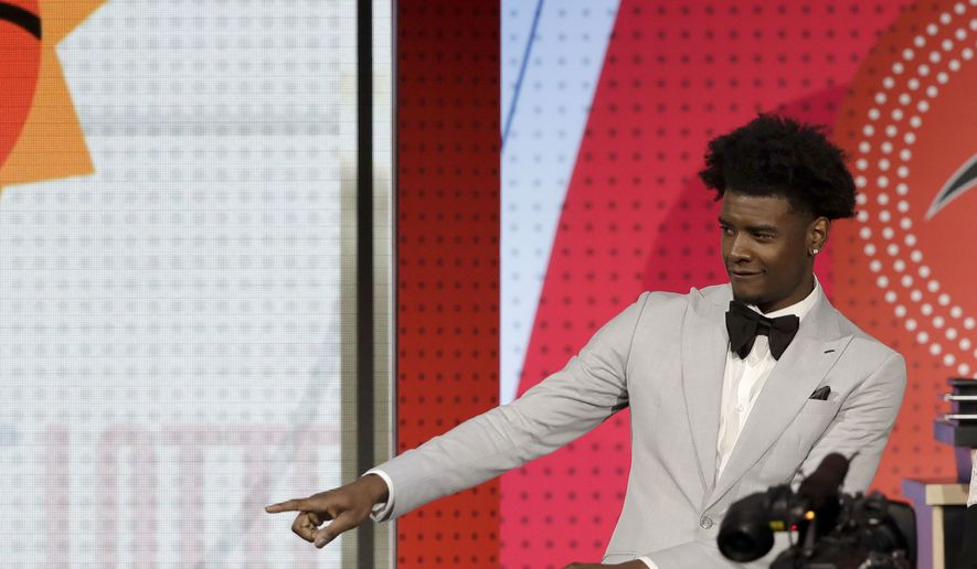 Phoenix Suns forward Josh Jackson reacts after the team won the first pick of the 2018 NBA Draft during the NBA basketball draft lottery Tuesday, May 15, 2018, in Chicago. (AP Photo/Charles Rex Arbogast)