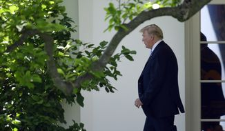 President Donald Trump walks out of the Oval Office and towards Marine One on the South Lawn of the White House in Washington, Tuesday, May 15, 2018, as he heads to Walter Reed National Medical Center to visit with first lady Melania Trump who is recovering from a kidney procedure. (AP Photo/Susan Walsh)