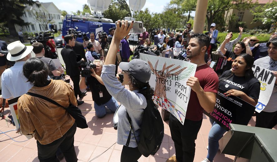 Supporters of the Deferred Action for Childhood Arrivals Act (DACA) and others demonstrate outside the U.S. District Court 9th Circuit in Pasadena, Calif., Tuesday, May 15, 2018. The Trump administration will try to convince a U.S. appeals court that it was justified in ending an Obama-era immigration policy that shielded hundreds of thousands of young immigrants from deportation. (AP Photo/Reed Saxon)