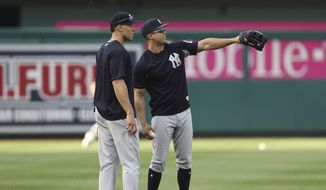 New York Yankees' Giancarlo Stanton, right, and teammate Aaron Judge, left, look over the field at Nationals Park before the start of an interleague baseball game against the Washington Nationals, Tuesday, May 15, 2018, in Washington. (AP Photo/Pablo Martinez Monsivais) **FILE**