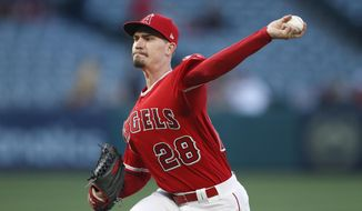 Los Angeles Angels starting pitcher Andrew Heaney throws against the Houston Astros during the first inning of a baseball game, Monday, May 14, 2018, in Anaheim, Calif. (AP Photo/Jae C. Hong)