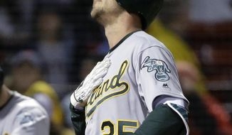 Oakland Athletics' Stephen Piscotty looks up as he arrives at home plate after hitting a home run off Boston Red Sox's Eduardo Rodriguez during the second inning of a baseball game Tuesday, May 15, 2018, in Boston. (AP Photo/Steven Senne)