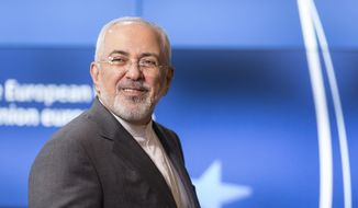 In this file photo, Iranian Foreign Minister Javad Zarif arrives prior to a meeting of the E-3 and Iran at the Europa building in Brussels on Tuesday, May 15, 2018. (Thierry Monasse, Pool Photo via AP) **FILE**