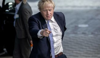 British Foreign Secretary Boris Johnson arrives prior to meet German Foreign Minister Heiko Maas, French Foreign Minister Jean-Yves Le Drian, European Union foreign policy chief Federica Mogherini and Iranian Foreign Minister Javad Zarif at the European Council building in Brussels, Tuesday, May 15, 2018. (AP Photo/Olivier Matthys)