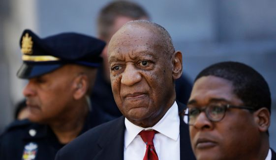 In this April 26, 2018 file photo, Bill Cosby, center, leaves the the Montgomery County Courthouse in Norristown, Pa. Cosby will be sentenced on Sept. 24, five months after he was convicted of sexual assault. (AP Photo/Matt Slocum, File)