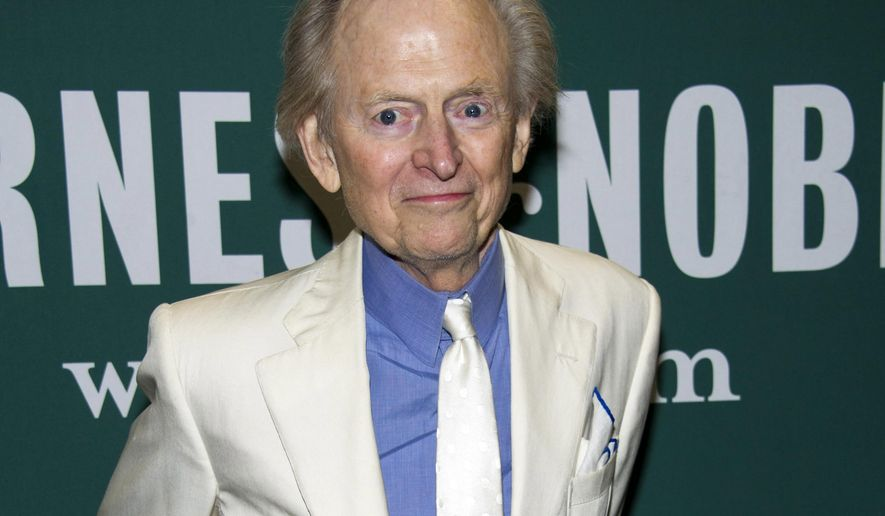 "CORRECTS AGE TO 88 - FILE - This Oct. 23, 2012 file photo shows author Tom Wolfe at a book signing for his novel ""Back to Blood"" at Barnes & Noble in New York. Wolfe died at a New York City hospital. He was 88. Additional details were not immediately available. (Photo by Charles Sykes/Invision/AP, file)"