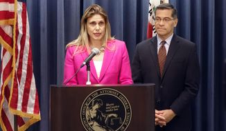 Maggy Krell, chief counsel of Planned Parenthood Affiliates of California, speaks during a news conference in Los Angeles, Tuesday, May 15, 2018, with California Attorney General Xavier Becerra about lawsuits challenging the Trump Administration's attempt to change rules they say will limit access to family planning services. Becerra and 19 other attorneys general filed legal papers Tuesday supporting lawsuits filed against the president in Washington federal court by groups that promote birth control. (AP Photo/Brian Melley)