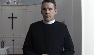 """This image released by A24 shows Ethan Hawke in a scene from """"First Reformed."""" (A24 via AP)"""