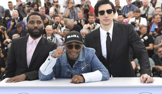 "Actor John David Washington, from left, director Spike Lee, and Adam Driver pose for photographers during a photo call for the film ""BlacKkKlansman"" at the 71st international film festival, Cannes, southern France, Tuesday, May 15, 2018. (Photo by Arthur Mola/Invision/AP)"
