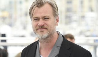 Director Christopher Nolan poses for photographers during a photo call for Rendezvous with Christopher Nolan at the 71st international film festival, Cannes, southern France, Saturday, May 12, 2018. (Photo by Arthur Mola/Invision/AP)