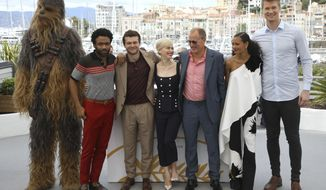 A person wearing a costume of the character Chewbacca, from left, actors Donald Glover, Alden Ehrenreich, Emilia Clarke, Woody Harrelson, Thandie Newton and Joonas Suotamo pose for photographers during a photo call for the film 'Solo: A Star Wars Story' at the 71st international film festival, Cannes, southern France, Tuesday, May 15, 2018. (Photo by Vianney Le Caer/Invision/AP)