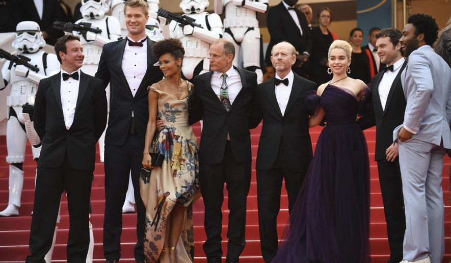 Actors Donald Glover, from right, Alden Ehrenreich, Emilia Clarke, director Ron Howard, actors Woody Harrelson, Thandie Newton, and Joonas Suotamo pose for photographers upon arrival at the premiere of the film 'Solo: A Star Wars Story' at the 71st international film festival, Cannes, southern France, Tuesday, May 15, 2018. (Photo by Arthur Mola/Invision/AP)