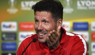 Atletico de Madrid head coach Diego Simeone, reacts during a press conference in Lyon, central France, Tuesday May, 15, 2018 ahead of the the UEFA Europa League Final against Olympique Marseille. (UEFA, Pool via AP)