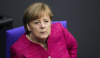German Chancellor Angela Merkel attends the first day of the budget 2018 debate at the parliament Bundestag at the Reichstag building in Berlin, Tuesday, May 15, 2018. (AP Photo/Markus Schreiber)