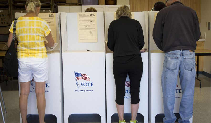 """Voter turnout at the Seventh Day Adventist Church in Eagle, Idaho has been steady. Nearly 50 people had voted by 9:15 a.m. """"That's good for us,"""" says poll worker Jackie Dahl. (Katherine Jones/Idaho Statesman via AP)"""