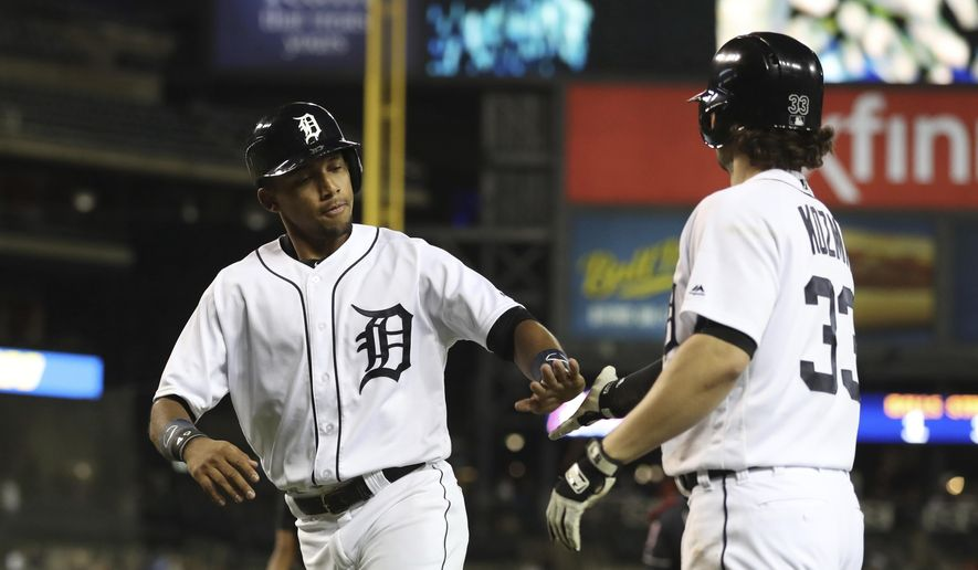 Detroit Tigers' Dixon Machado is congratulated by Pete Kozma after scoring during the seventh inning of a baseball game against the Cleveland Indians, Tuesday, May 15, 2018, in Detroit. (AP Photo/Carlos Osorio)