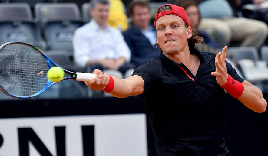 Tomas Berdych, of Czech Republic, returns a ball to Denis Shapovalov, of Canada, during the Italian Open tennis tournament, Tuesday,  May 15, 2018. (Claudio Onorati/ANSA via AP)