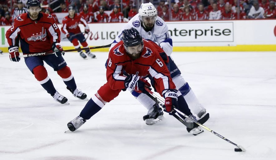 Washington Capitals defenseman Michal Kempny (6), from the Czech Republic, skates with the puck with Tampa Bay Lightning center Cedric Paquette (13) behind him during the first period of Game 3 of the NHL Eastern Conference finals hockey playoff series, Tuesday, May 15, 2018, in Washington. (AP Photo/Alex Brandon) ** FILE **