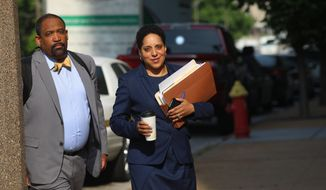 St. Louis Circuit Attorney Kim Gardner, right, and Ronald Sullivan, a Harvard law professor, arrive at the Civil Courts building for the third day of jury selection in Missouri Gov. Eric Greitens' invasion of privacy trial, Monday, May 14, 2018, in St. Louis. Prosecutors on Monday abruptly dropped the invasion-of-privacy charge against Greitens but said they still hope to pursue a case against him for allegedly taking a revealing photo of a woman with whom he has acknowledged having an affair. The surprise move came after the judge had granted a request by Greitens' lawyers to call Gardner as a witness for the defense. (Christian Gooden/St. Louis Post-Dispatch via AP)