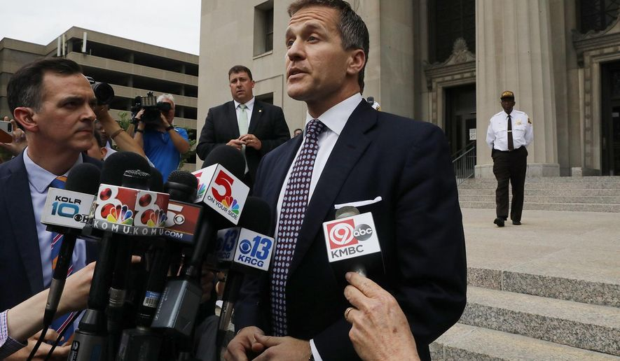 Missouri Gov. Eric Greitens addresses the media on the steps of the Civil Court building on Monday, May 14, 2018, after the case against him was dismissed. Greitens declared victory Monday as prosecutors abruptly dropped a felony invasion-of-privacy charge alleging he had taken a revealing photo of a woman with whom he has acknowledged having an affair. (J.B. Forbes/St. Louis Post-Dispatch via AP)