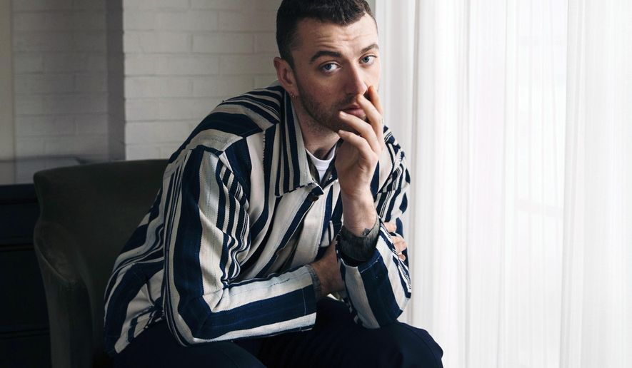 """FILE - In this Nov. 2, 2017 file photo, musician Sam Smith poses for a portrait in New York to promote his album, """"The Thrill of It All."""" A study of hundreds of thousands of popular songs over the last three decades has found a downward sonic trend in happiness and an increase in sadness. Some songs with a low happiness index in 2014 include """"Stay With Me"""" by Smith. (Photo by Victoria Will/Invision/AP, File)"""