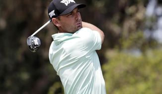 Charles Howell III follows his shot from the 16th tee, during the second round of The Players Championship golf tournament Friday, May 11, 2018, in Ponte Vedra Beach, Fla. (AP Photo/Lynne Sladky)