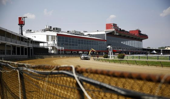 Preparations take place for the Preakness Stakes horse race at Pimlico Race Course, Tuesday, May 15, 2018, in Baltimore. Old Hilltop is showing its age and it will cost an estimated $300 million to make it right. So while the group that owns the track promises the middle jewel of the Triple Crown will stay put in 2019, there's a chance that the 145th running of the Preakness in 2020 will be held within the state at newer, fresher Laurel Park. (AP Photo/Patrick Semansky) **FILE**