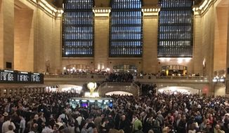 Commuters are stranded in Grand Central Terminal during the evening commute, Tuesday, May 15, 2018, in New York. The Metro-North commuter railroad said Tuesday evening that downed trees across the tracks had caused it to suspend service on its Harlem, Hudson and New Haven lines. (AP Photo/Donald King