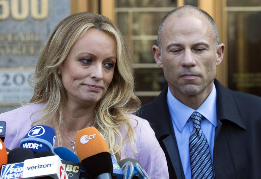 In this April 16, 2018 file photo, adult film actress Stormy Daniels, whose given name is Stephanie Clifford, and her attorney Michael Avenatti talk to reporters outside federal court in New York City. The hundreds of thousands of dollars that Stormy Daniels raised in her legal case against President Donald Trump came from an online crowdfunding site. But the unusual method of online fundraising for legal fees raises transparency questions about who is actually supporting the legal fight. Daniels and her attorney, Michael Avenatti, have raised more than $490,000 on the website CrowdJustice.com. (AP Photo/Mary Altaffer, File)
