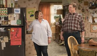 """This image released by ABC shows Roseanne Barr, left, and John Goodman in a scene from the comedy series """"Roseanne."""" Expect """"Roseanne"""" to cool it on politics and concentrate on family stories when it returns for the second season of its revival next year. ABC Entertainment chief Channing Dungey noted that as the first season went on, the focus shifted from politics to family. She said that direction will continue next season. (Adam Rose/ABC via AP)"""