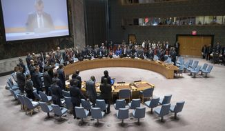 The United Nations Security Council observes a moment of silence for those killed during the deadly violence along the Israel-Gaza border before a meeting to discuss the situation, Tuesday, May 15, 2018, at United Nations headquarters. (AP Photo/Mary Altaffer)