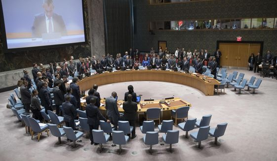 The United Nations Security Council observes a moment of silence for those killed during the deadly violence along the Israel-Gaza border before a meeting to discuss the situation, Tuesday, May 15, 2018, at United Nations headquarters. (AP Photo/Mary Altaffer) ** FILE **