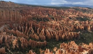 FILE - In this May 25, 2017, file photo, shows a view of the world-famous hoodoos, also called tent rocks, fairy chimneys and earth pyramids, at Inspiration Point in Bryce Canyon National Park in Utah. Utah authorities are investigating reports of drinking water contaminated by E. coli linked to prairie dogs at Bryce Canyon National Park, but say tests so far show it's clean. The sheriff near the iconic park that saw 2.5 million visitors last year said Tuesday, May 15, 2018, county leaders are alarmed about contamination reports linked to feces from nearby prairie dogs. (AP Photo/Eva Parziale, File)