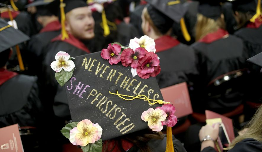 A graduate wears a hat with a message during an undergraduate commencement ceremony for Ramapo College in Newark, N.J., Thursday, May 10, 2018. (AP Photo/Seth Wenig)