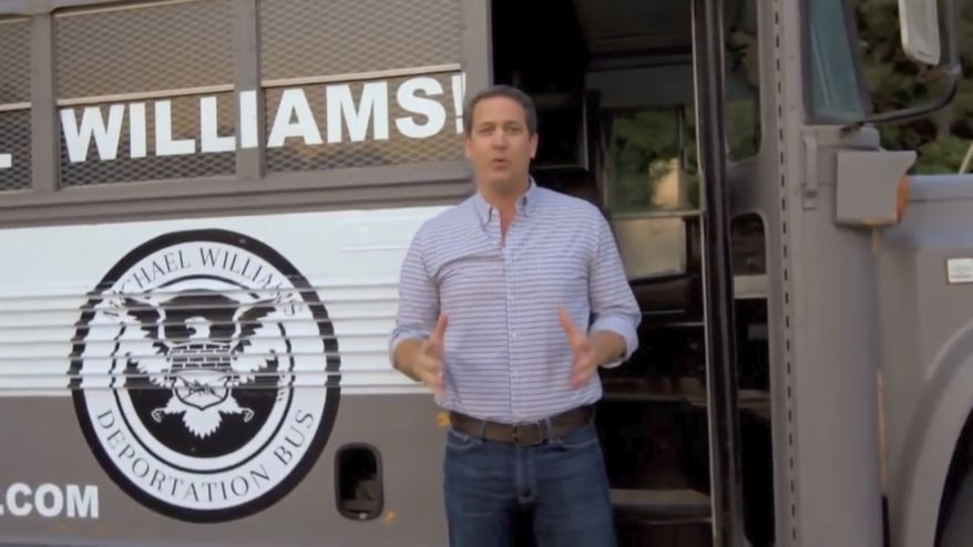 """In this frame from video provided by the Michael Williams for Governor campaign, Williams shows off his """"Deportation Bus"""" in an advertisement. News outlets report Williams will bring the bus to what his campaign calls Georgia's """"dangerous sanctuary cities"""" beginning Wednesday, May 16, 2018. (Michael Williams for Governor via AP)"""