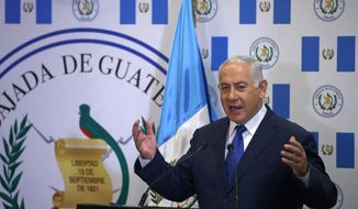 Israeli Prime Minister Benjamin Netanyahu speaks during the dedication ceremony of the embassy of Guatemala in Jerusalem, Wednesday, May 16, 2018. Guatemala has opened its new embassy in Jerusalem, becoming the second country to do so after the United States. (Ronen Zvulun/Pool Photo via AP)