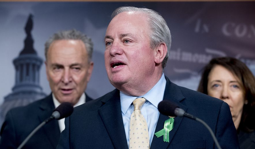 Rep. Mike Doyle, D-Pa., center, accompanied by Senate Minority Leader Sen. Chuck Schumer of N.Y., left, and Sen. Maria Cantwell, D-Wash., right, speaks at a news conference on Capitol Hill in Washington, Wednesday, May 16, 2018, after the Senate passes a resolution to reverse the FCC decision to end net neutrality. (AP Photo/Andrew Harnik)