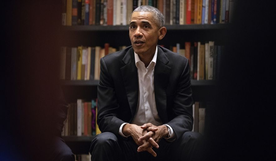 Former President Barack Obama  speaks to Obama Foundation Fellows gathered at Stony Island Arts Bank Wednesday, May 17, 2018, in Chicago.  (Erin Hooley/Chicago Tribune via AP)